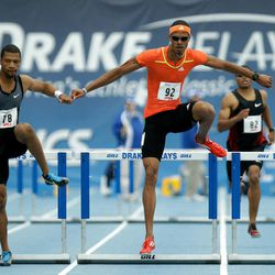 Culson Javier, right, leads Johnny Dutch during the men's special 400-meter hurdles at the Drake Relays athletics meet, Saturday, April 28, 2012, in Des Moines, Iowa.
