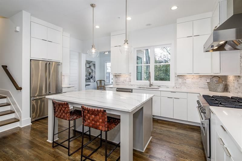 A white kitchen with white cabinets.