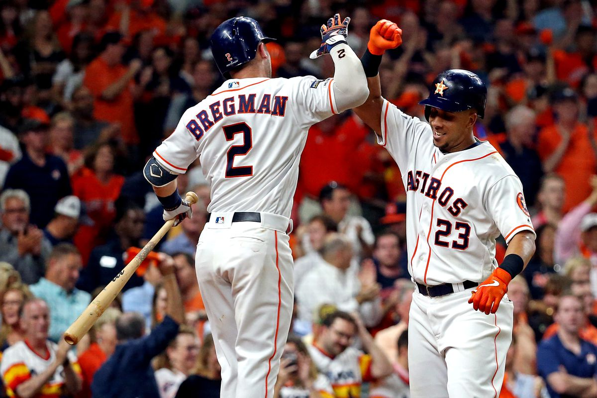 Houston Astros left fielder Michael Brantley celebrates with shortstop Alex Bregman after hitting a home run during the eighth inning against the Tampa Bay Rays in game five of the 2019 ALDS playoff baseball series at Minute Maid Park.