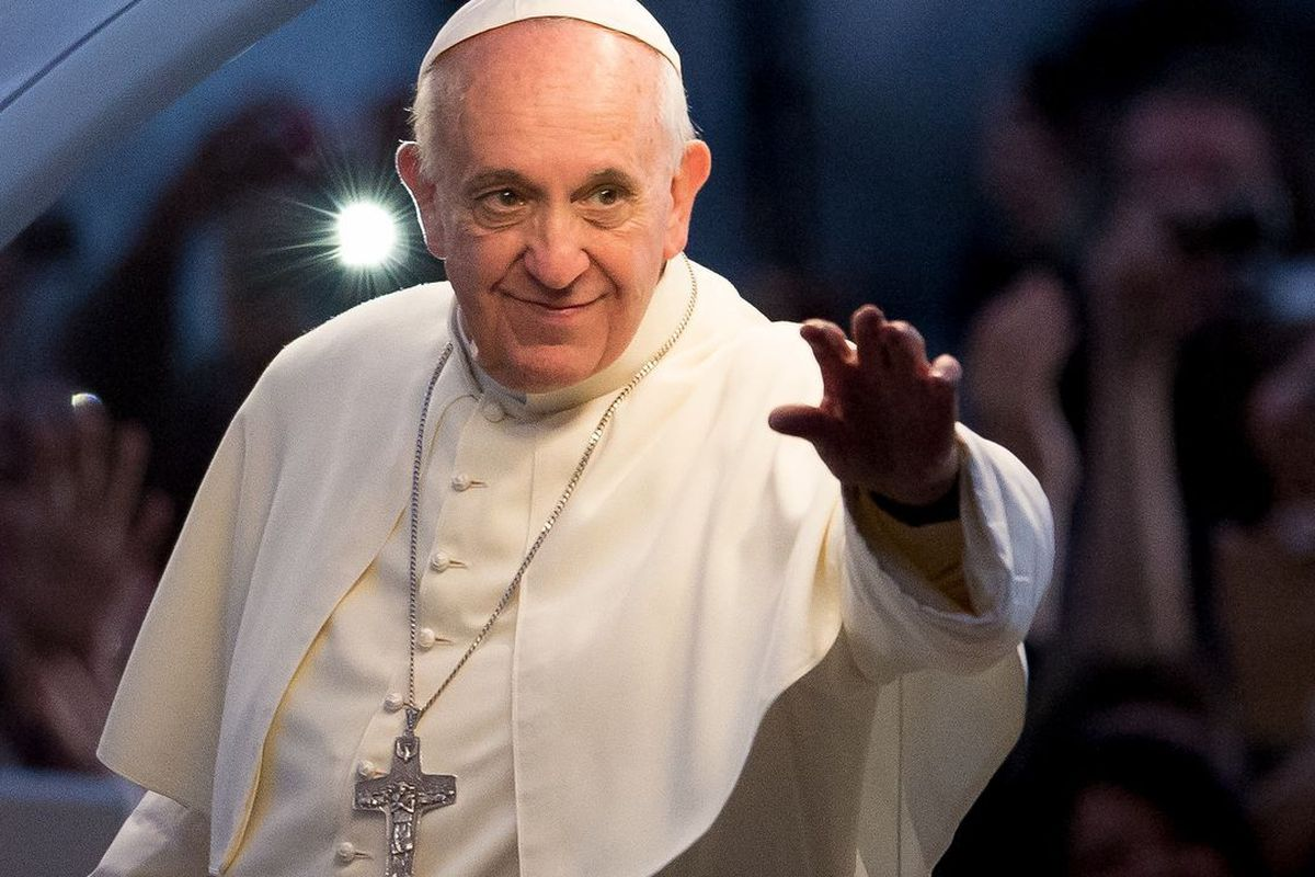 Pope Francis waves from the popemobile on his way to attend the Via Crucis on Copacabana Beach during World Youth Day celebrations on July 26, 2013, in Rio de Janeiro, Brazil.