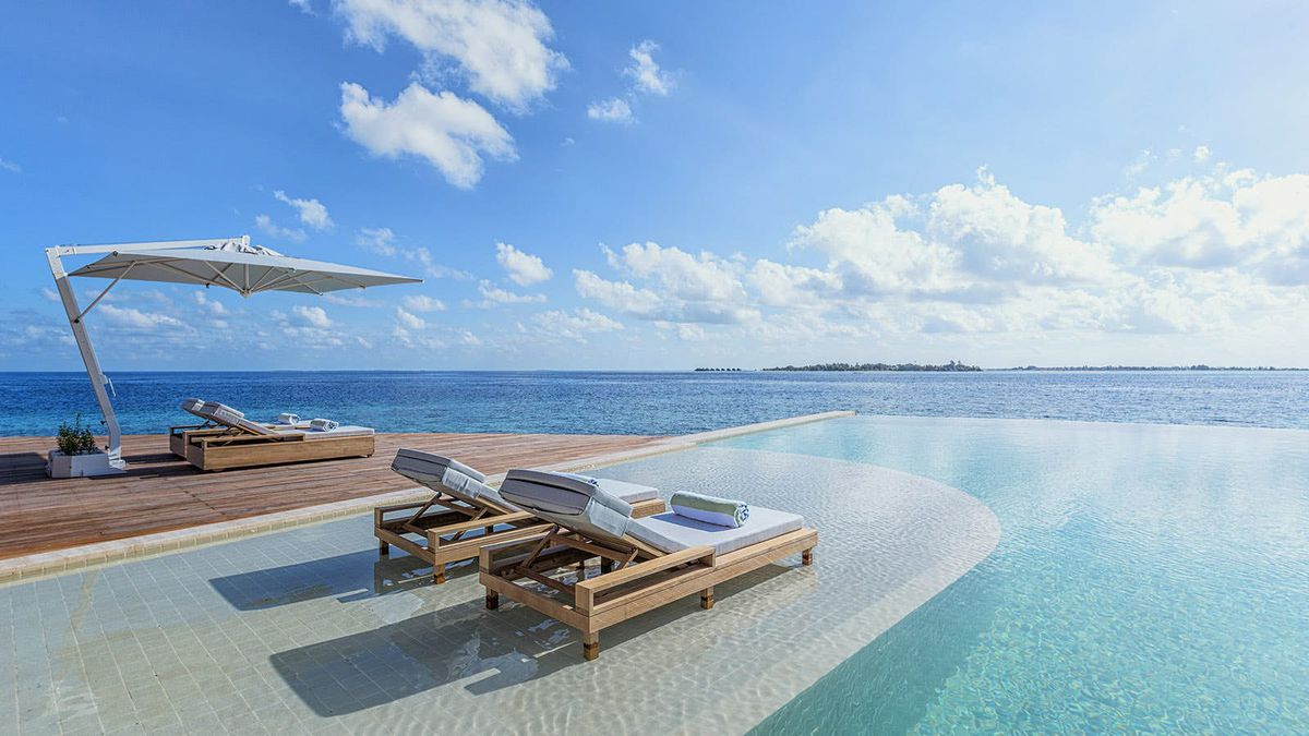 Infinity pool with pool chairs