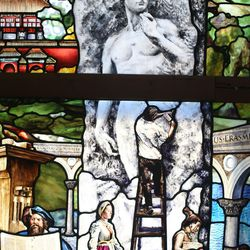 """An image of Michelangelo sculpting the statue of David is depicted in a section of """"Roots of Knowledge"""" at Holdman Studios at Thanksgiving Point in Lehi on Friday, Sept. 16, 2016. A Guardian UK reporter called the work """"one of the most spectacular stained glass windows made in the past century."""""""