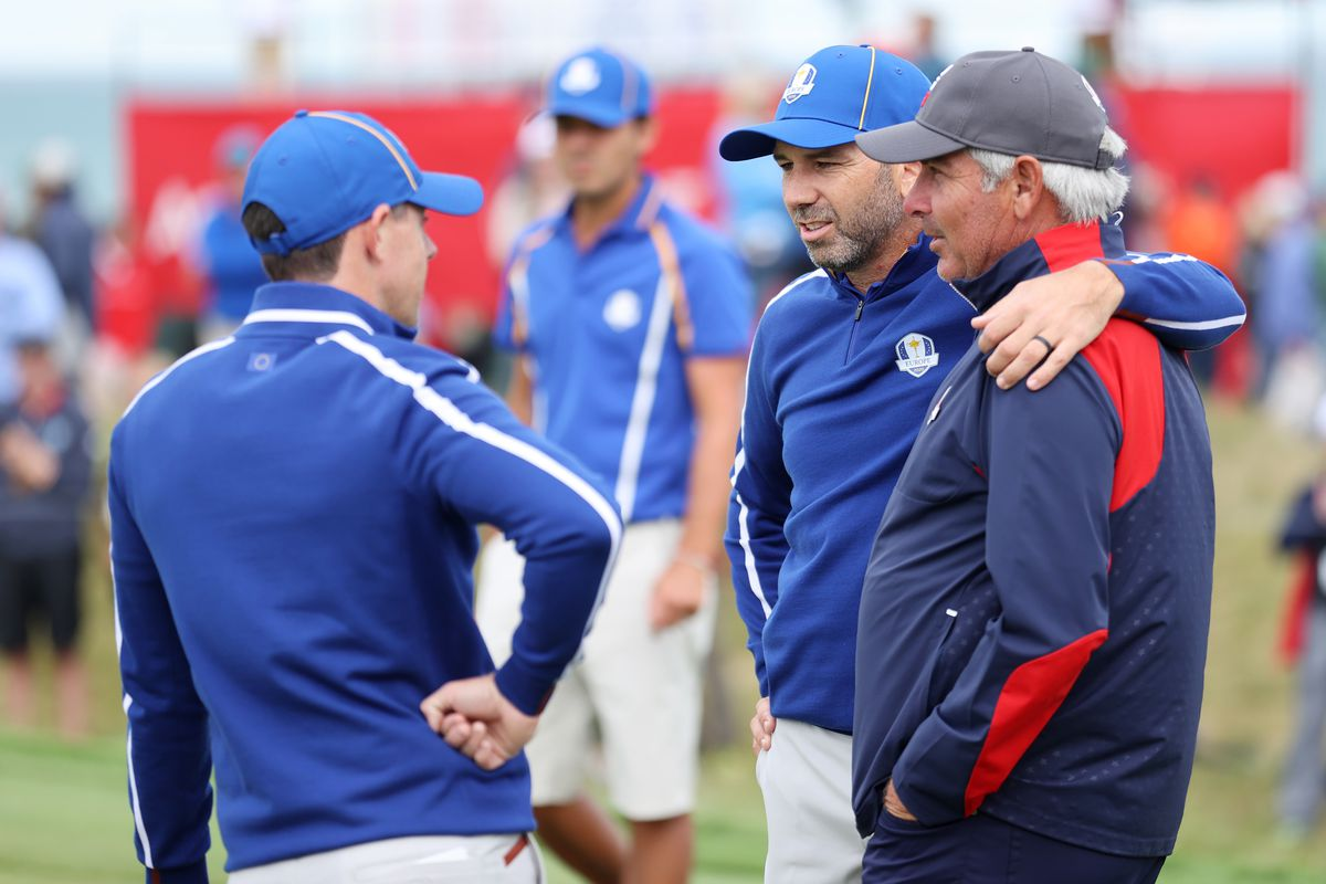 Rory McIlroy of Northern Ireland and team Europe, Sergio Garcia of Spain and team Europe, and vice-captain Fred Couples of team United States meet on the 15th green prior to the 43rd Ryder Cup at Whistling Straits on September 21, 2021 in Kohler, Wisconsin.