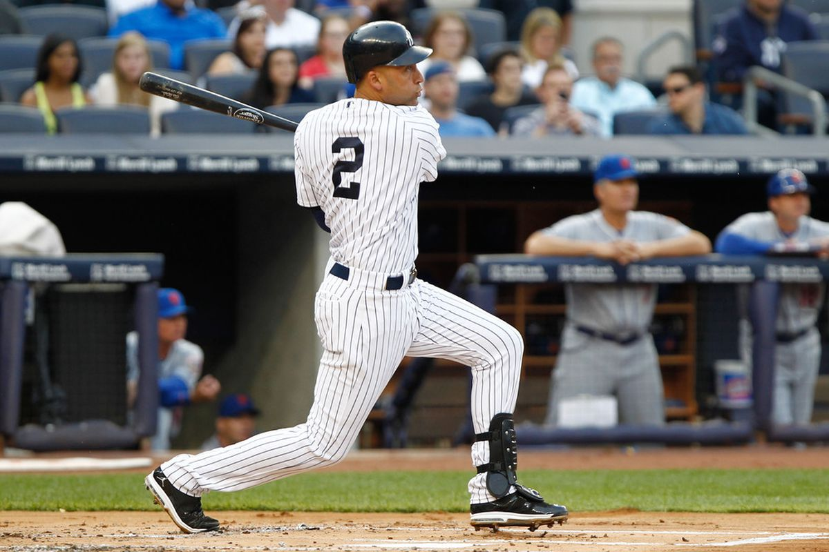 June 9, 2012; Bronx, NY, USA; New York Yankees shortstop Derek Jeter (2) singles to center against the New York Mets during the first inning at Yankee Stadium. Debby Wong-US PRESSWIRE