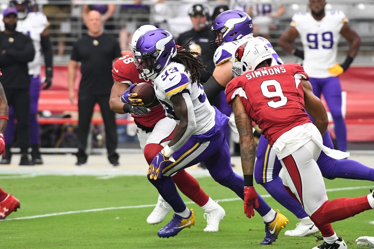Dalvin Cook #33 of the Minnesota Vikings runs with the ball against the Arizona Cardinals at State Farm Stadium on September 19, 2021 in Glendale, Arizona.