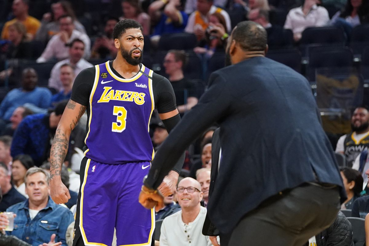 Los Angeles Lakers forward Anthony Davis celebrates with forward LeBron James against the Golden State Warriors during the third quarter at Chase Center.