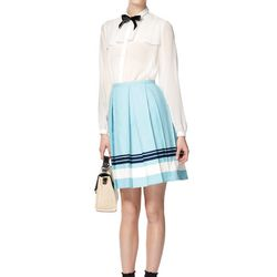Look 7: Long-Sleeve Sheer Blouse in White with Black Ribbon, $34.99 (Available at Target.com only) Also Available in Blush with White Dots Pleated Canvas Skirt in Belize Blue, $29.99 Front-Flap Straw Bag in Cream, $39.99