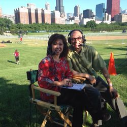 Linda Yu and Jim Rose covering the Chicago Blackhawks victory rally in 2013.