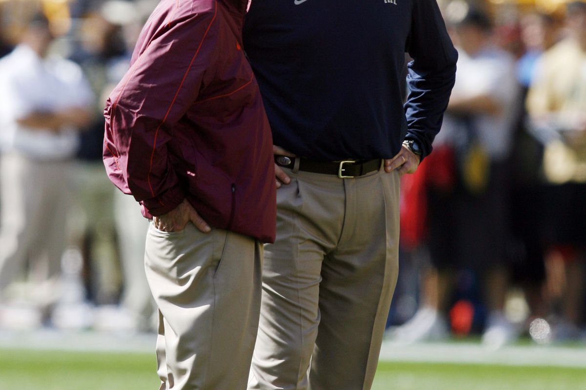 September 15, 2012; Pittsburgh, PA, USA; Virginia Tech Hokies head coach Frank Beamer (left) and Pittsburgh Panthers head coach Paul Chryst (right) talk on the field before their game at Heinz Field. Mandatory Credit: Charles LeClaire-US PRESSWIRE