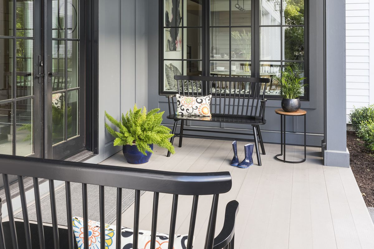 Side porch with black benches