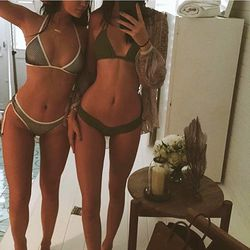 Kendall and Kylie sport (almost) matching green bikinis.