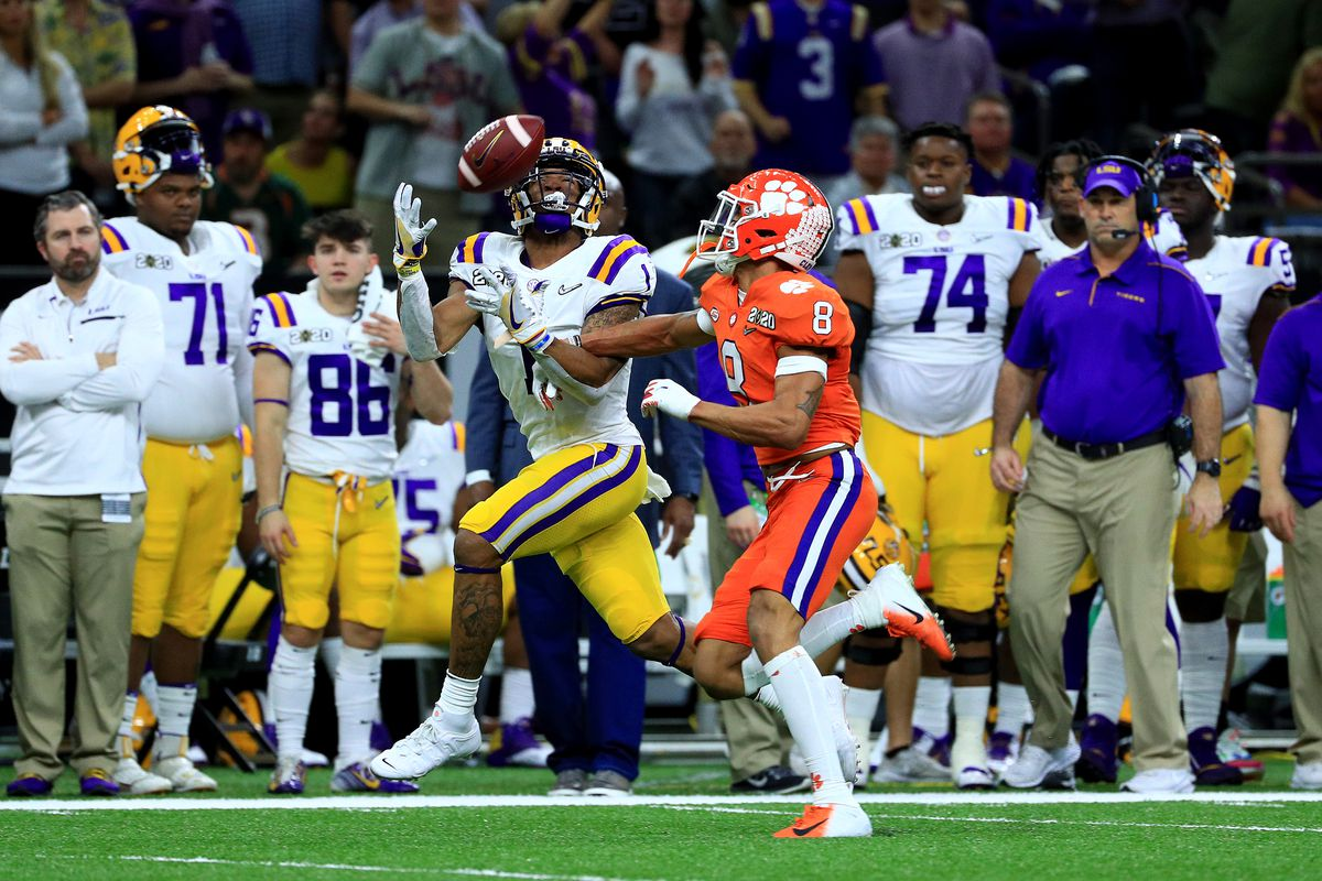 Ja'Marr Chase of the LSU Tigers catches a pass as A.J. Terrell of the Clemson Tigers defends in the College Football Playoff National Championship game at Mercedes Benz Superdome on January 13, 2020 in New Orleans, Louisiana.