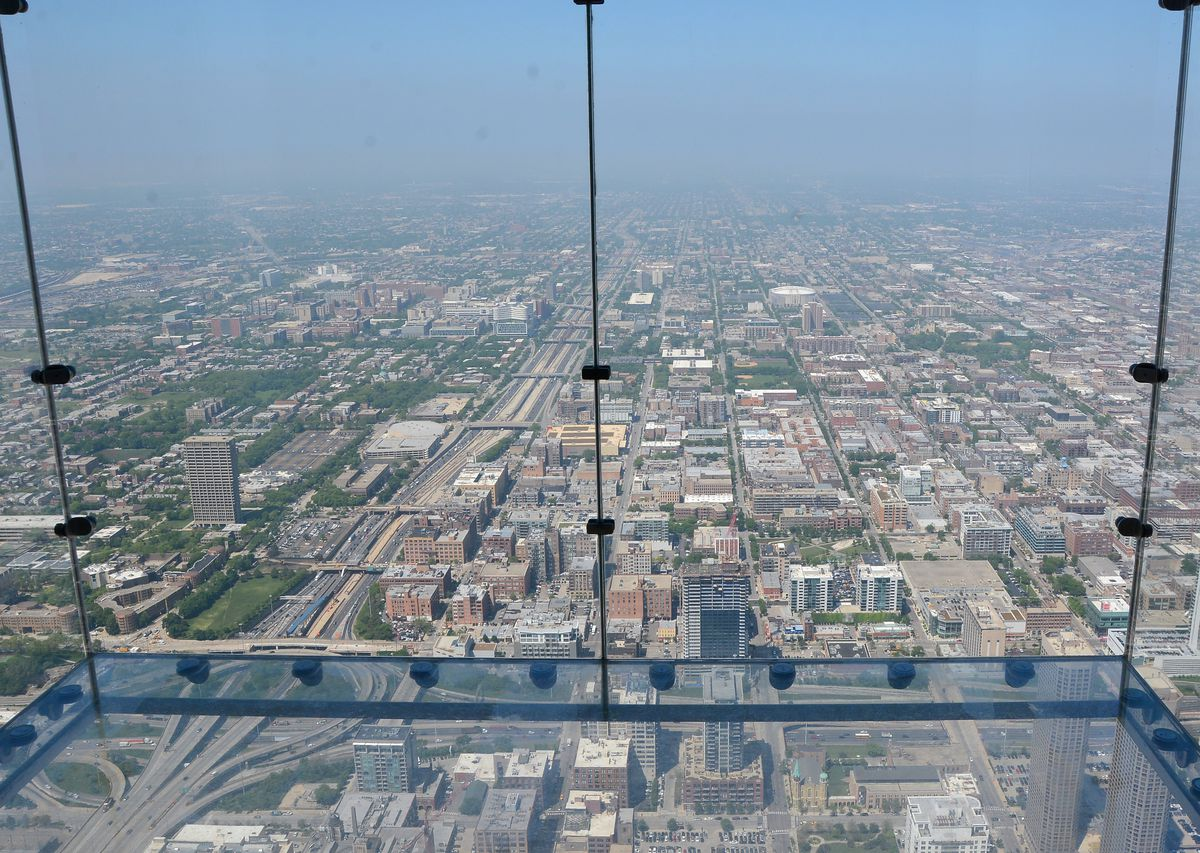 The Willis Tower Skydeck has added glass-floored observation ledges that jut out from the building, allowing visitors to look straight down. | Sun-Times