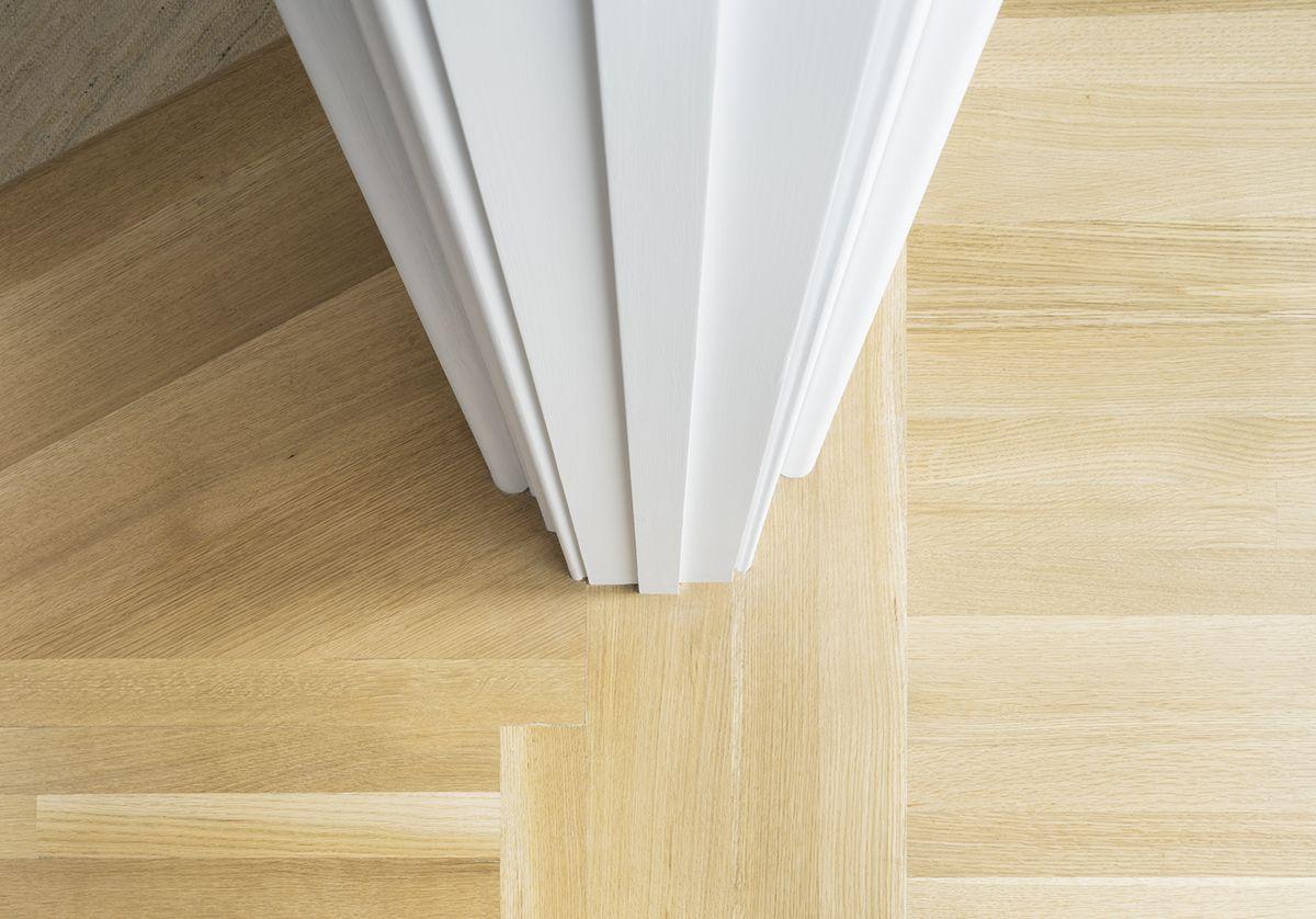 Detail of the custom white oak flooring installation.