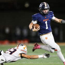 Brighton's Gabe Curtis (1) runs the ball for a first down during a high school 5A football quarterfinal against Timpview at Brighton High School in Cottonwood Heights on Friday, Nov. 6, 2020.