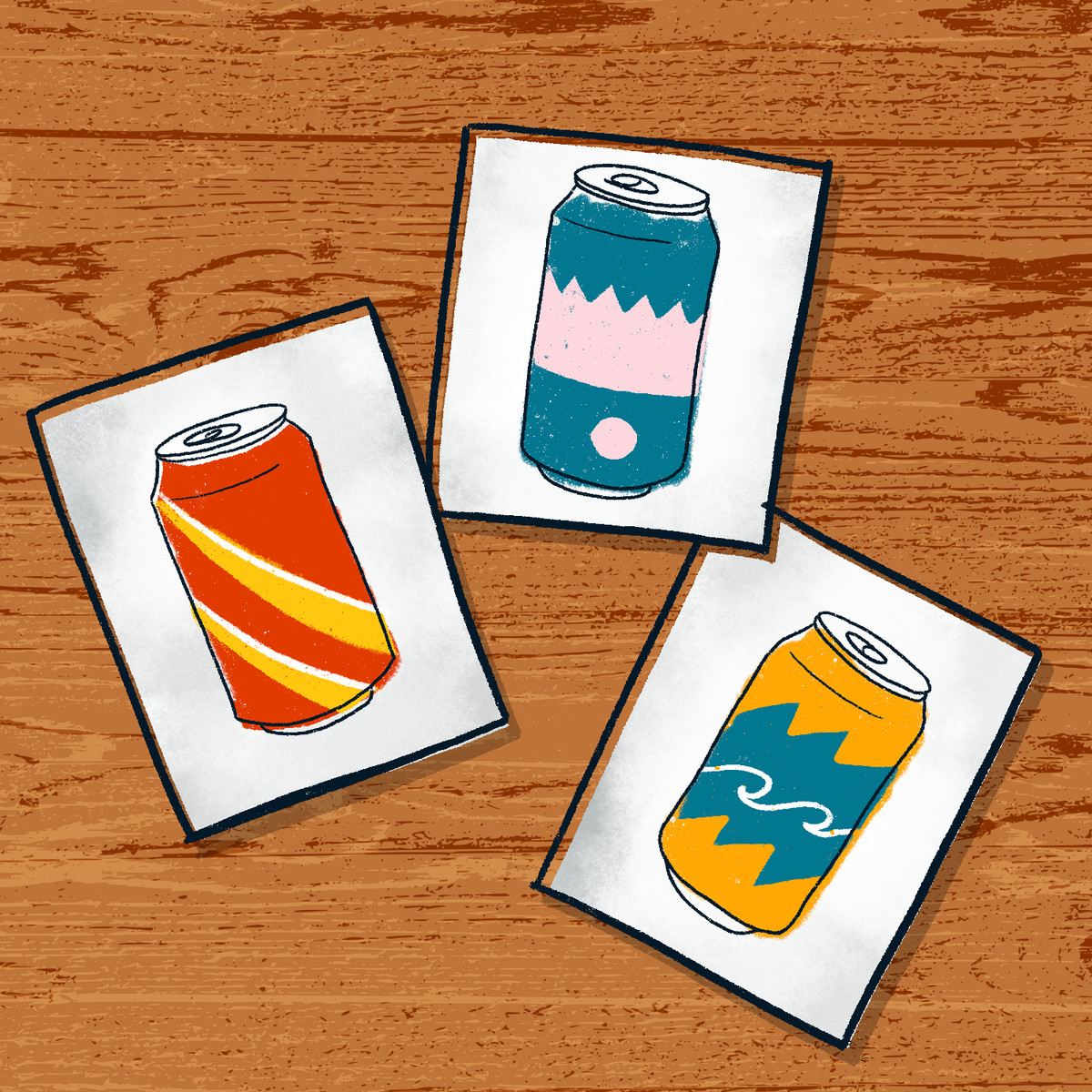 Cards with different soda cans designs laid out on a table