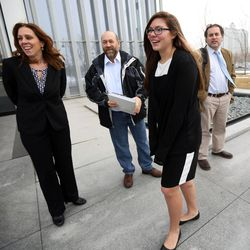 Kelly Janis, Lee Garcia, Kathleen Janis and Monte Sleight gather outside the federal courthouse in Salt Lake City on Wednesday, Feb. 1, 2017. Kathleen, a ninth-grade student at Central Davis Junior High, is suing the Davis School District because she isn't allowed to participate in her school's wrestling program.