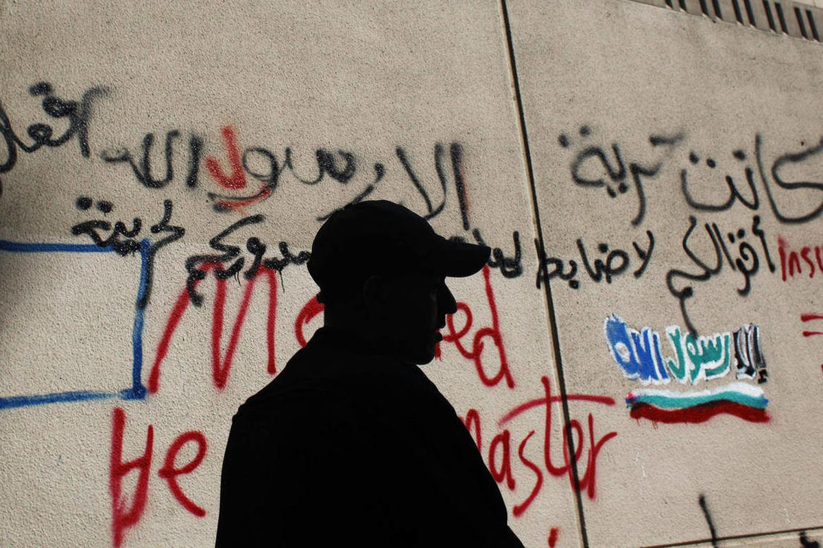 An Egyptian soldier stands guard in front of the U.S. embassy in Cairo, Egypt, Wednesday, Sept. 12, 2012.