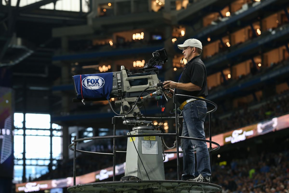 A FOX Sports television camera operator is seen during regular season game action between the Minnesota Vikings and the Detroit Lions on October 20, 2019 at Ford Field in Detroit, Michigan.