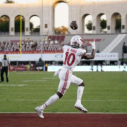 Utah wide receiver Money Parks (10) makes a touchdown catch during the first half of the team's NCAA college football game against Southern California on Saturday, Oct. 9, 2021, in Los Angeles.