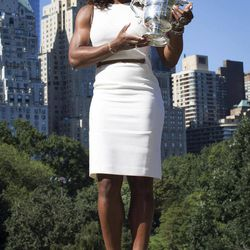 2012 U.S. Open Women's Singles champion Serena Williams poses for a photo with her trophy in Central Park, Monday, Sept. 10, 2012, in New York. This year alone, Williams claimed the U.S. Open trophy alongside the gold medals she won at the London Olympics and the silver plate she took home from Wimbledon.
