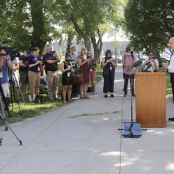 Salt Lake City Police Chief Mike Brown, right speaks during a press conference about updates to the city's police policies — including de-escalation efforts, use of force, body cameras and consent to search — outside of the City-County Building in Salt Lake City on Monday, Aug. 3, 2020.