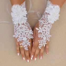 """<b>3. Finger Loop White Lace Gloves,</b>$35: These romantic white lace gloves will up the dreamy and pretty factor of your dress. The finger loop element adds interest and keeps them from not looking too sweet. Available online at  <a href=""""https://www.e"""