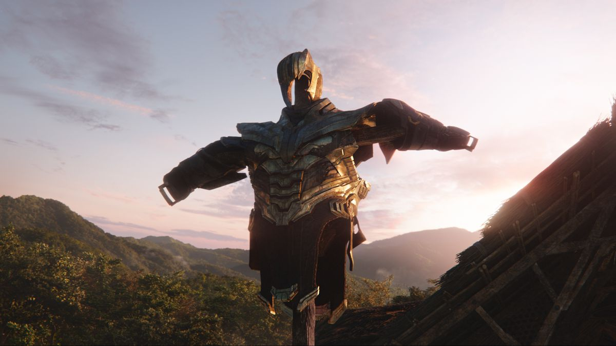 Thanos' empty armor rests on a wooden pole, acting as a scarecrow