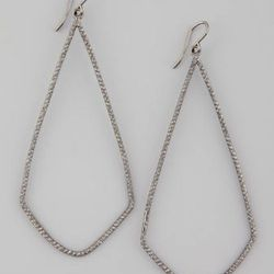 """Studs are great, but sometimes a girl needs dramatic earrings. These are a contemporary shape and combine the best elements of hoop and chandelier shapes. $48, <a href=""""http://www.cusp.com/product.jsp?rte=%252Fetemplate%252Fp6E.jsp%253FNtpc%253D1%2526pare"""
