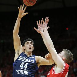 Brigham Young Cougars center Corbin Kaufusi (44) pushes up a shot over Utah Utes forward Jakob Poeltl (42) as Utah and BYU play in the Huntsman Center in Salt Lake City Wednesday, Dec. 2, 2015.