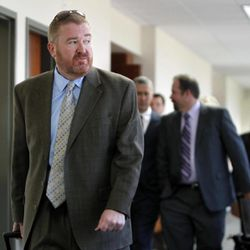Defense Attorney Daniel King, left, leads the defense team out of the courtroom after a hearing for suspected theater shooter James Holmes in district court in Centennial, Colo., on Thursday, Sept. 20, 2012.  Holmes has been charged in the shooting at the Aurora theater on July 20 that killed twelve people and injured more than 50.