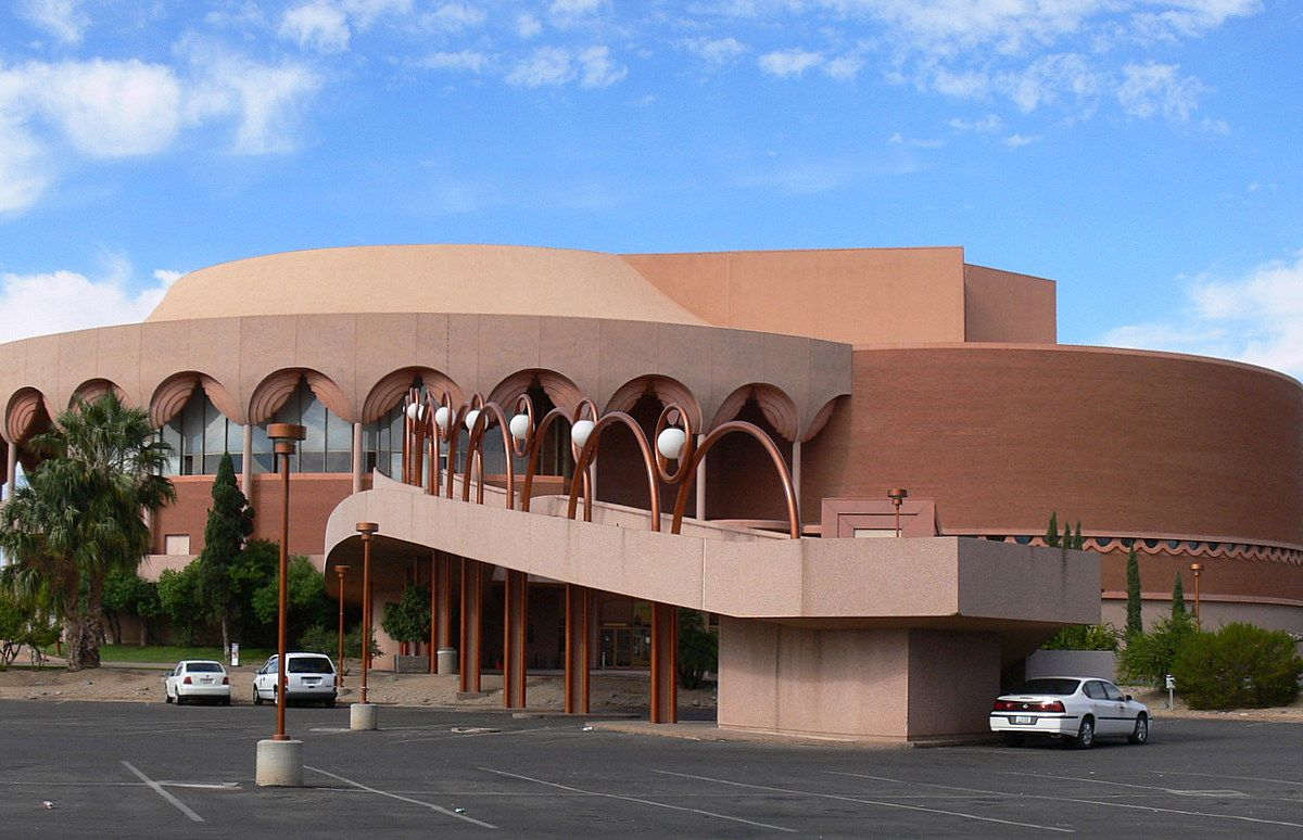 The ASU Gammage Auditorium by Frank Lloyd Wright. The facade is brown and tan. The building shape is circular.