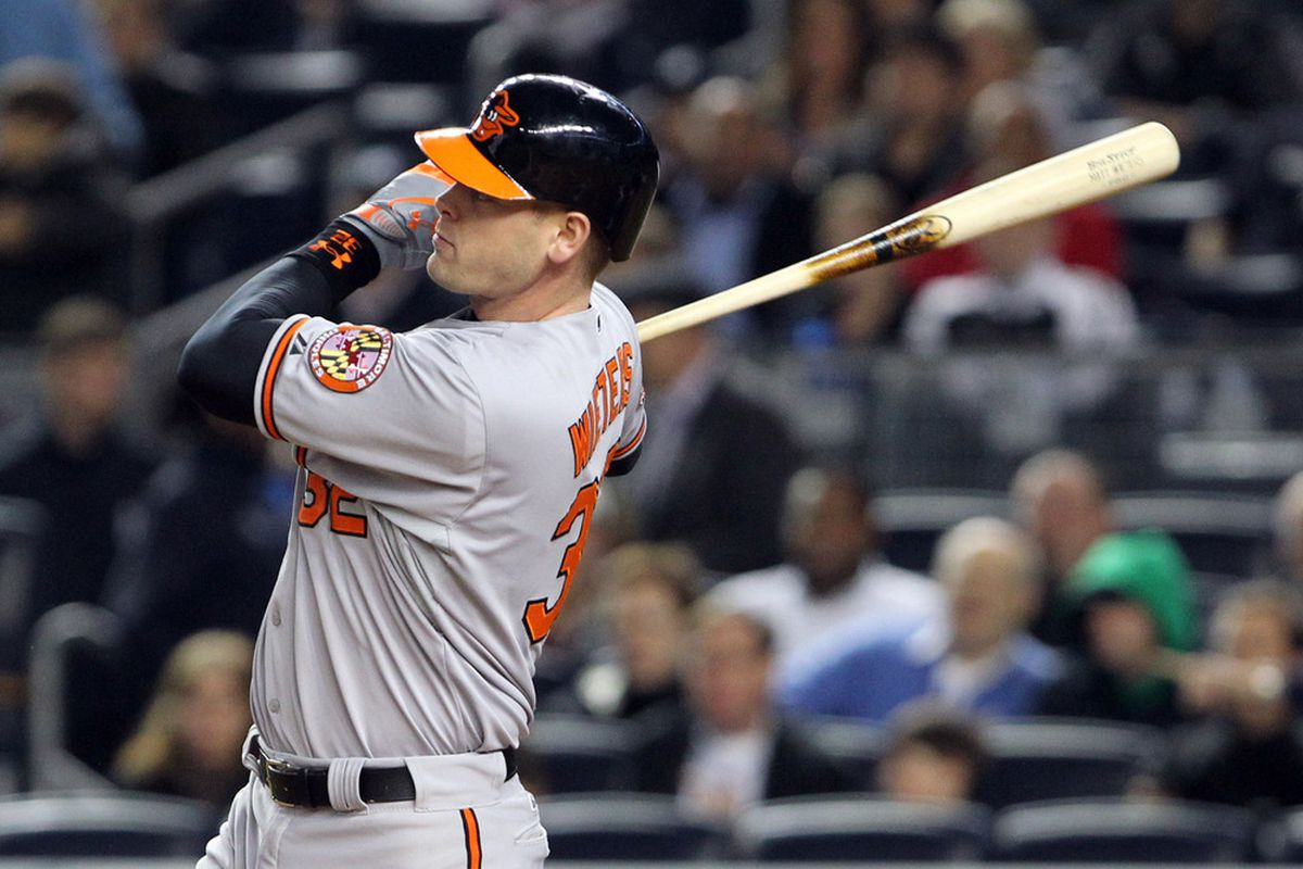 May 2, 2012; Bronx, NY, USA; Baltimore Orioles catcher Matt Wieters (32) hits a home run to right during the fourth inning against the New York Yankees at Yankee Stadium.  Baltimore won 5-0.  Mandatory Credit: Anthony Gruppuso-US PRESSWIRE