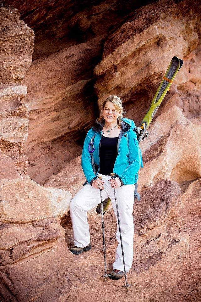 Erin Parisi is holding skis at Red Rocks.