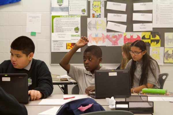 A student at DSST Cole Middle School in Denver raises his hand.