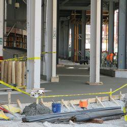 3:12 p.m. New concrete floor on the Waveland side of the main bleacher entrance -