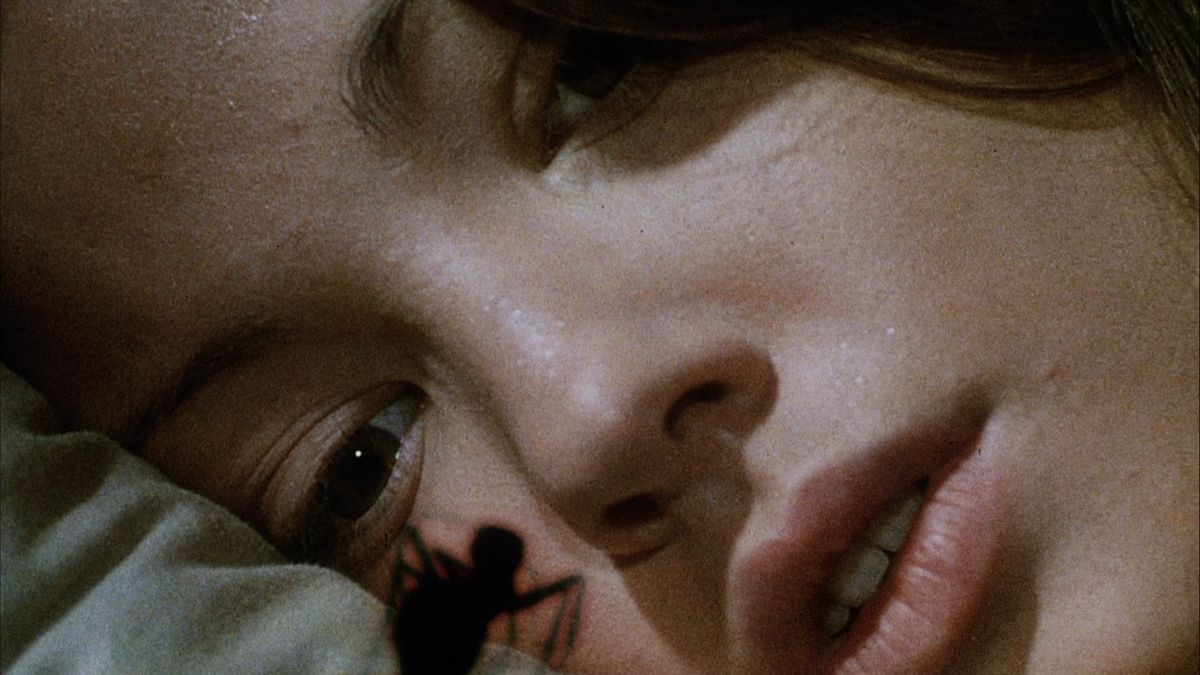 phase IV: an ant crawls up on a bed and looks at a girl in close up