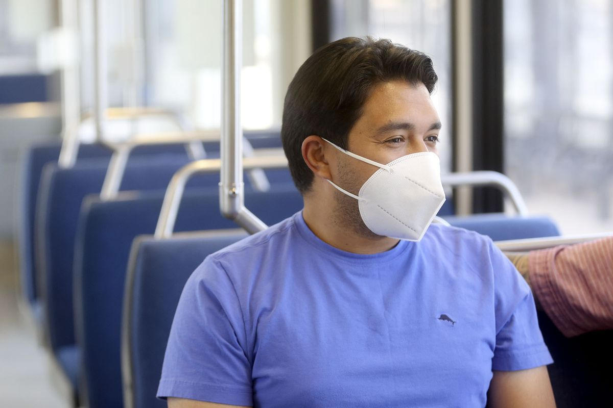 Tiberio Barros wears a face mask on a TRAX train at the Salt Lake Central Station in Salt Lake City on Wednesday, July 1, 2020. The Utah Transit Authority now requires face masks be worn in order to ride public transit in compliance with the Salt Lake County health order.