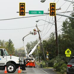 Utility crews work on a utility pole that was damaged by high winds in Centerville on Tuesday, Sept. 8, 2020.