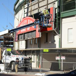 1:32 p.m. The upper portion of the marquee being lowered to the ground -