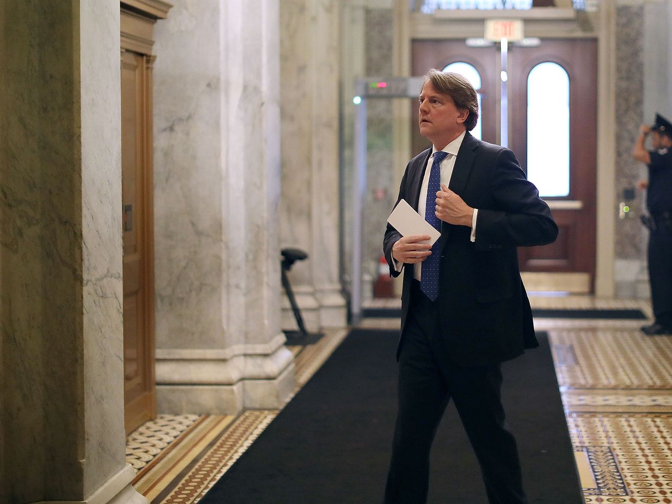 White House counsel Don McGahn after a meeting in Washington, DC in July 2018. He's reportedly speaking at length with Robert Mueller out of concern he's the fall guy for Trump.