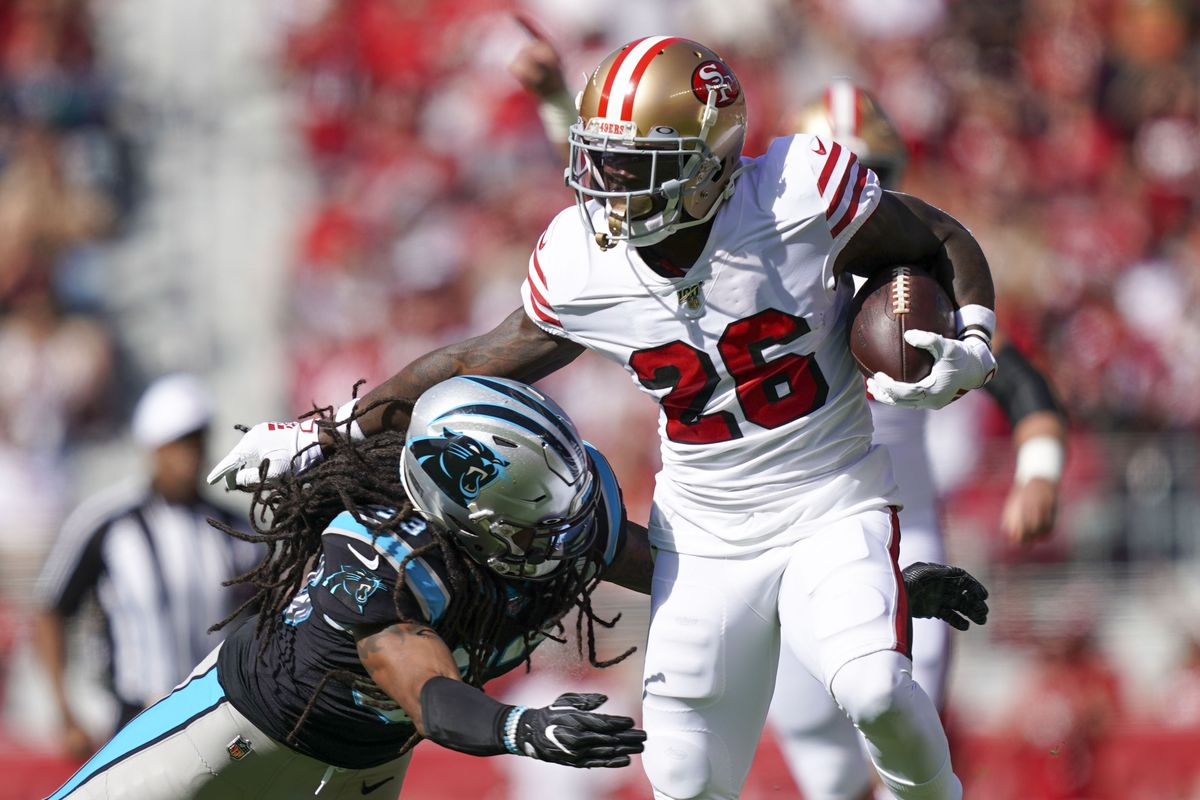 San Francisco 49ers running back Tevin Coleman runs against Carolina Panthers defensive back Tre Boston during the first quarter at Levi's Stadium.