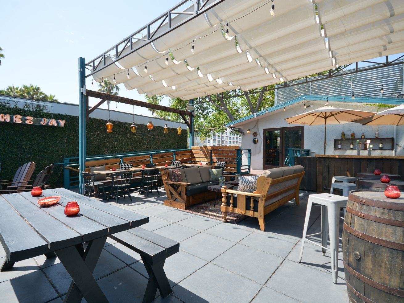 New back patio at Santa Monica dive Chez Jay with picnic benches and tables