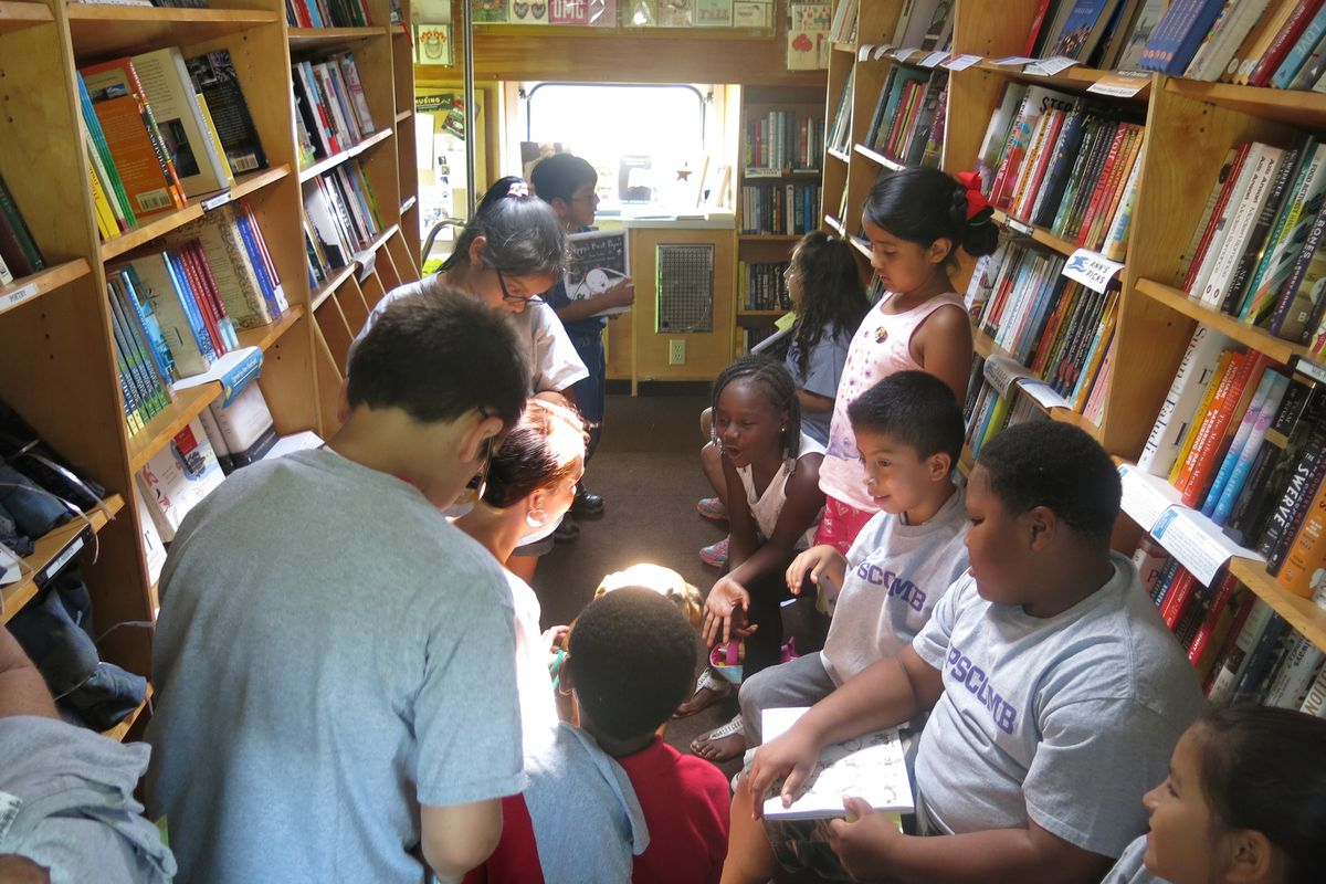 Students at Nashville's J.E. Moss Elementary School check out reading options on a bookmobile sponsored by Parnassus Books, a local bookstore. A new citywide initiative aims to bring in more community partners to support the district's literacy efforts.