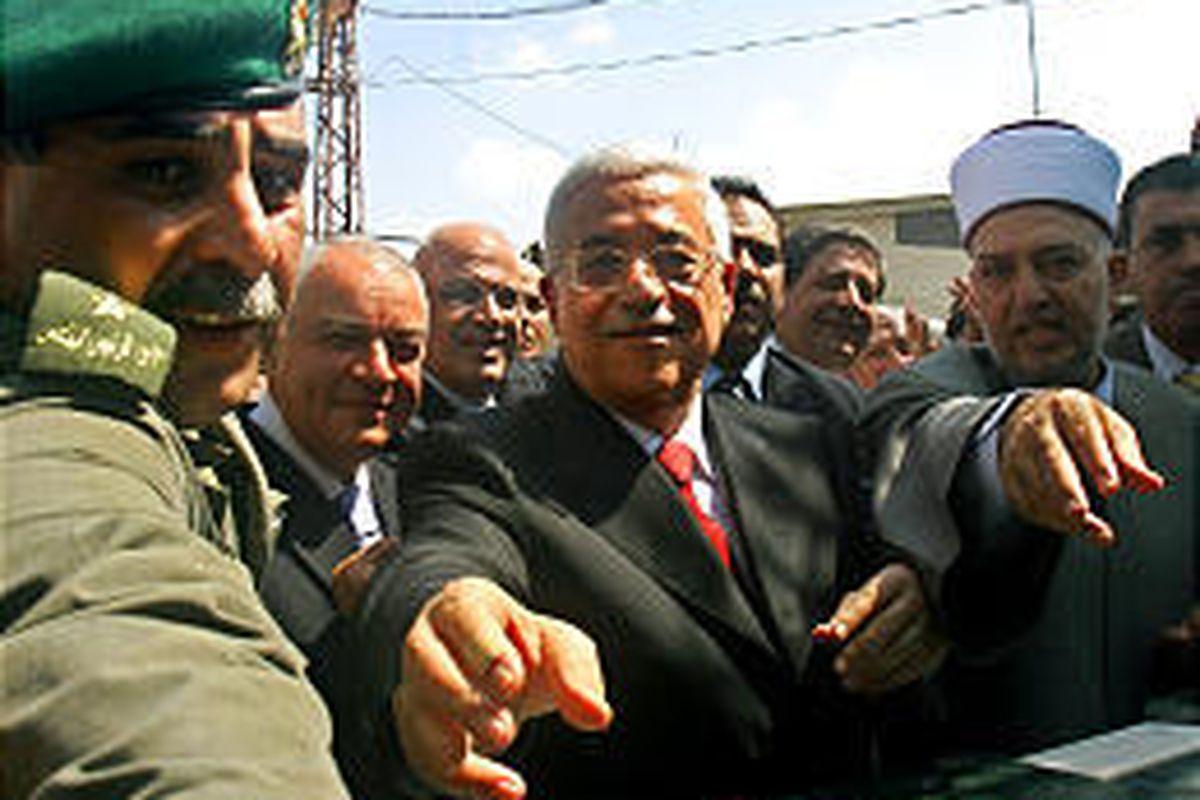 Palestinian President Mahmoud Abbas, center, attends a sod-turning ceremony at Abu Khadra Islamic hospital in Gaza City Monday.