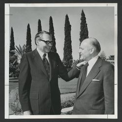 Elder L. Tom Perry, left, and Elder Howard W. Hunter visit on the Mesa Arizona Temple grounds before the temple's rededication in April 1975.
