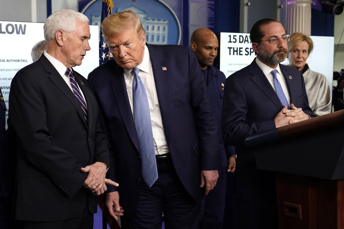 President Donald Trump listens to Vice President Mike Pence as Health and Human Services Secretary Alex Azar speaks.
