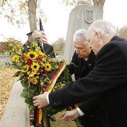 President Dieter F. Uchtdorf places a wreath with the help of Charles Dahlquist.