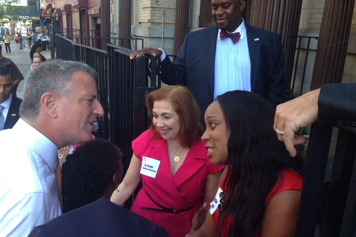 Staff from Amber Charter School greet Mayor Bill de Blasio on a visit in September.