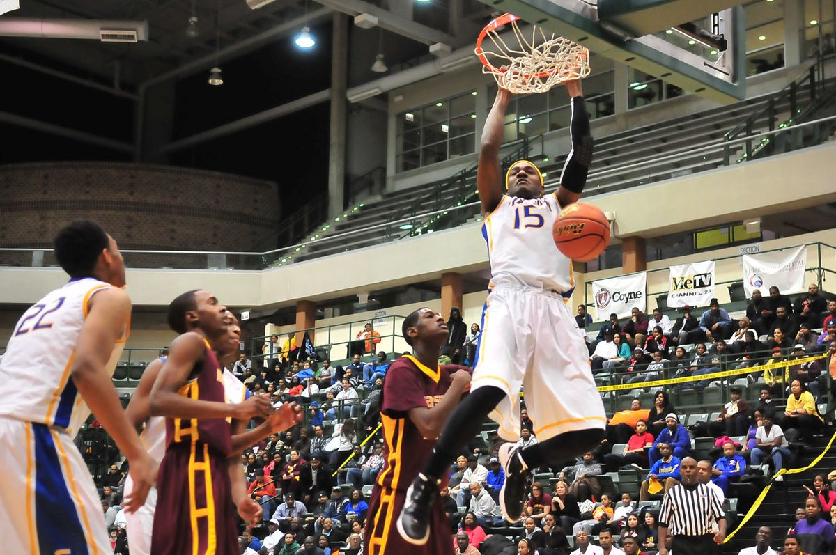 Simeon's Steve Taylor powers a two-handed dunk against Marshall.